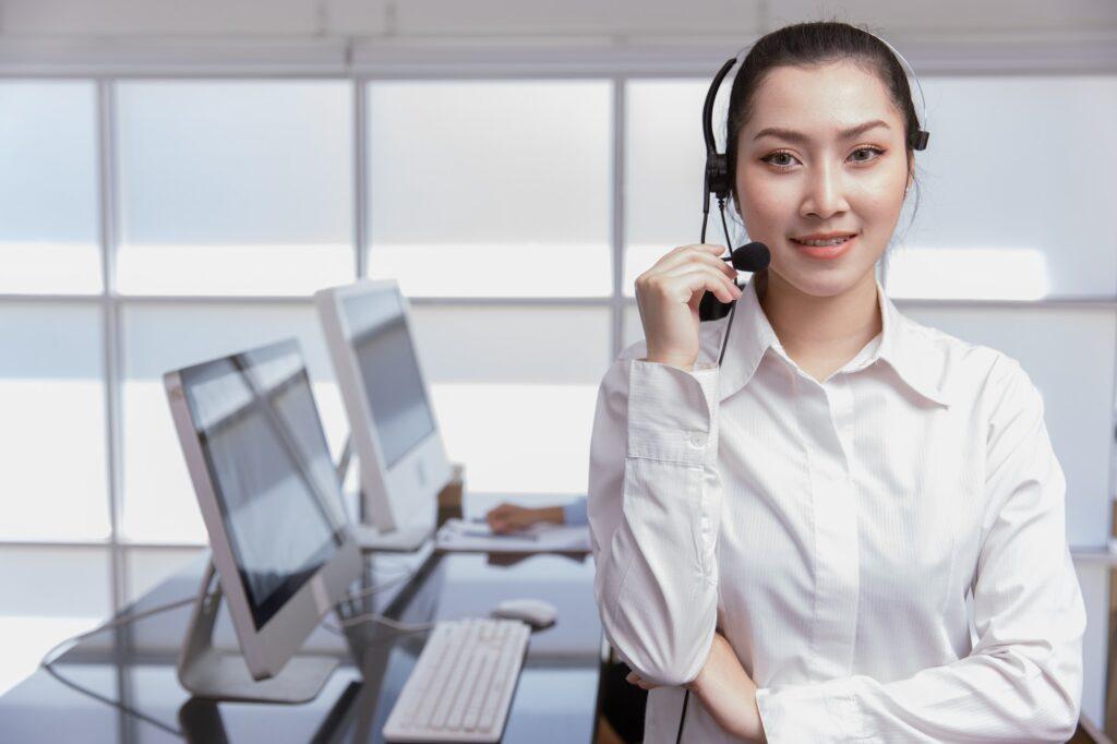 Portrait Asian women business office call center operator. Helpdesk support phone call team worker